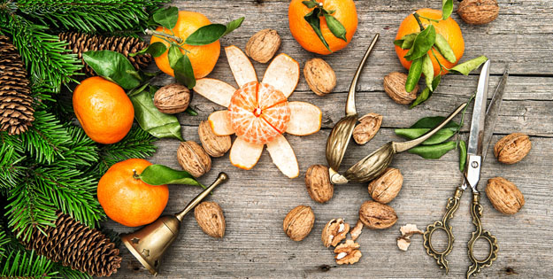 tangerine fruits and walnuts with christmas decoration