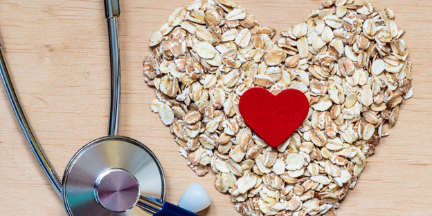Oat flakes heart shaped and stethoscope.