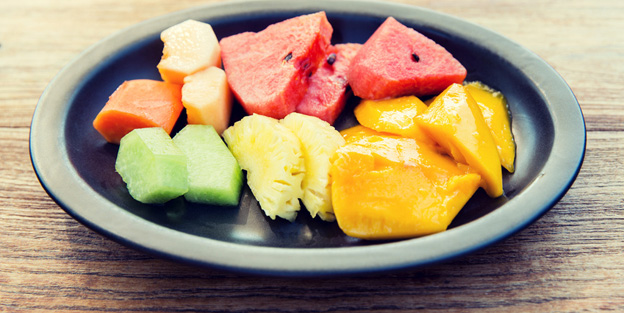 plate of fresh juicy fruits at asian restaurant