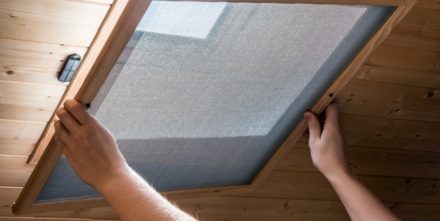 Installing homemade mosquito net on velux window on ceiling