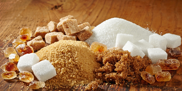 various types of sugar on wooden table